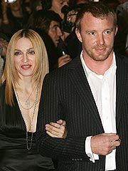 Madonna Prays in New York, Guy Ritchie Prays in London