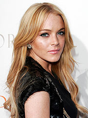 Report: Lindsay Lohan Flew to Mom in N.Y.