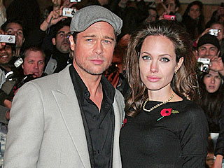 Brad Pitt Covers Angelina Jolie at Premiere (Correction)