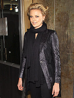 Charlize Theron Gets a Surprise from Jeremy Renner