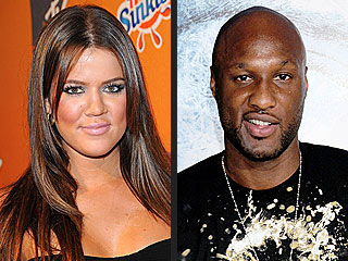 Lamar Odom Smiles Away Baby Rumors
