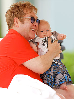 Elton John Holds His Son Zachary