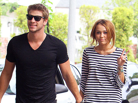 Miley Cyrus, Liam Hemsworth Greet Zac Efron in Hollywood