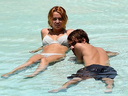 Miley Cyrus Engaged to Liam Hemsworth; Goes Swimming in Miami