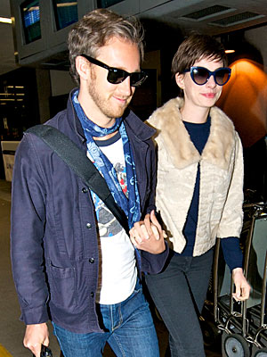 Anne Hathaway Returns from Honeymoon