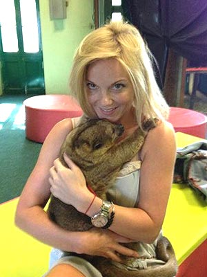 Russell Who? Geri Halliwell Cuddles Up to a Kinkajou
