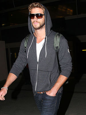 Liam Hemsworth Arrives Back in L.A.