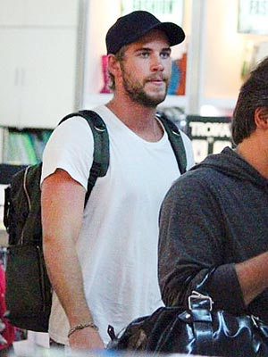Liam Hemsworth Debuts New Beard While Miley Cyrus Tweets Engagement Ring Photo