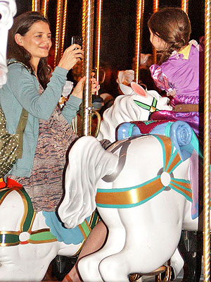 Katie Holmes & Suri Cruise Take Smiley Carousel Ride at Disney World
