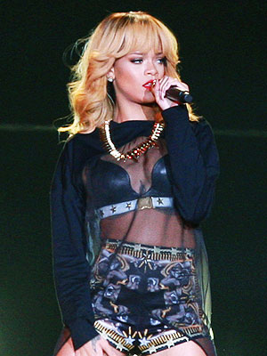 Rihanna Hits Fan with Microphone at Concert