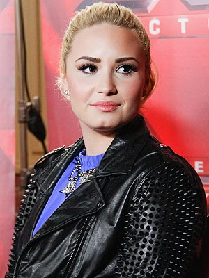 Demi Lovato Puts Dad to Rest