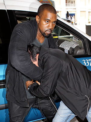 Kanye West Charged with Battery in Paparazzi Scuffle