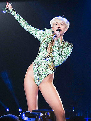 Miley Cyrus Gets Pumped Up in Promo for NBC Concert Special (VIDEO)