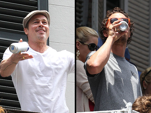 Brad Pitt Throws Matthew McConaughey a Beer in New Orleans