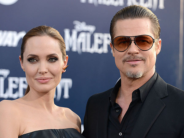 Brad Pitt Opens Up About 'Nutter' in Red Carpet Clash