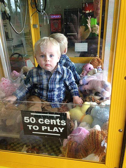 child in claw machine