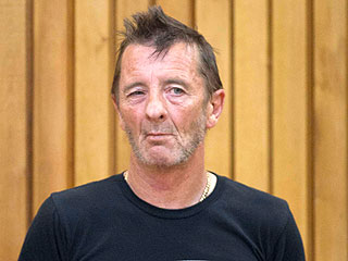 AC/DC Drummer Phil Rudd Behaves Strangely in Court: Jumps on Security Guard's Back