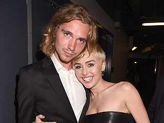Miley Cyrus Stands Behind Her Homeless VMAs Date