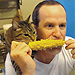 Cat Eats Corn on the Cob with His Owner