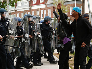 Officers Reportedly Injured as Violence in Baltimore Continues After Funeral for Freddie Gray