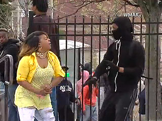 VIDEO: Baltimore Mom Drags Son from Riot