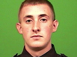 NYPD Officer Brian Moore 'Fighting for His Life' After Being Shot in the Head on Saturday