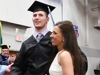 Watch This Paralyzed Graduate Walk to Receive His Diploma, With Help From His Fiancée