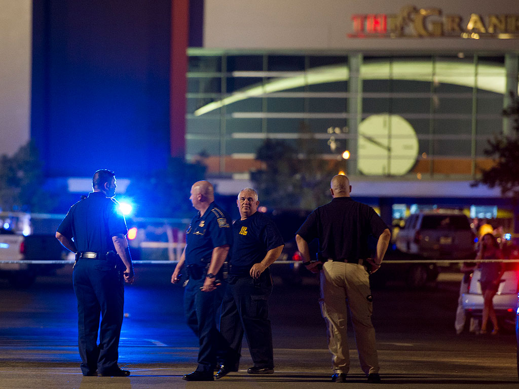 Hero Schoolteacher Shields Coworker in Fatal Shooting at Trainwreck Screening