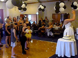 Girl Attempts to Catch Wedding Bouquet, Drops Baby Instead (VIDEO)