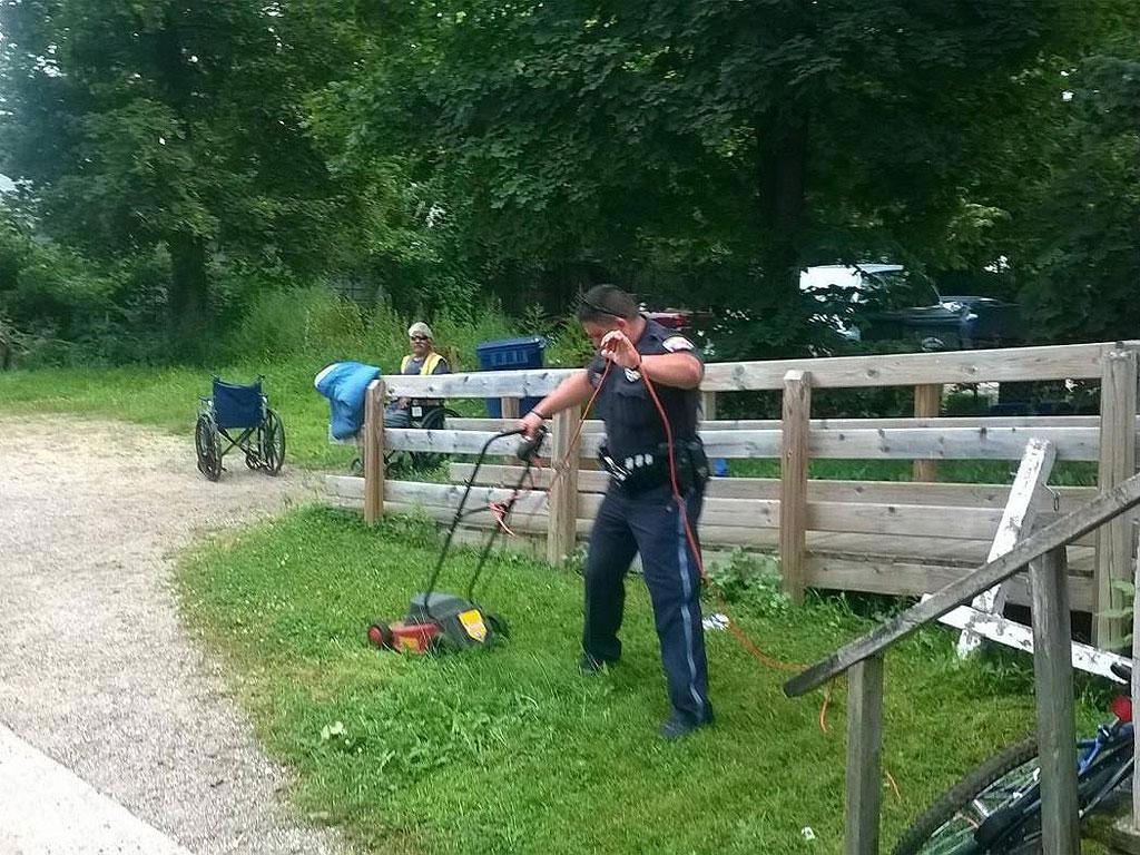 Michigan Cops Mow Lawn for Wheelchair-Bound Man