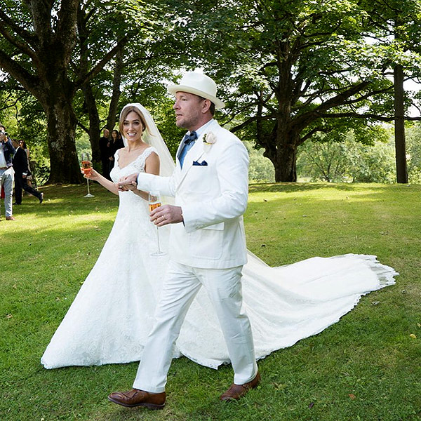 'Guy Ritchie Shares More Wedding Photos, Says of Son with His Ex Madonna, 'I Looked Something Like That 30 Years Ago'' from the web at 'http://img2-1.timeinc.net/people/i/2015/news/150817/guy-ritchie-600.jpg'