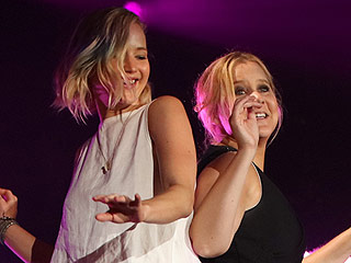 Uptown Girls! Watch Jennifer Lawrence & Amy Schumer Dance on Billy Joel's Piano  During Surprise Concert Appearance