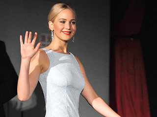 'Jennifer Lawrence Brings the Heat in an Icy Gown on the Hunger Games Press Tour' from the web at 'http://img2-1.timeinc.net/people/i/2015/stylewatch/blog/151123/jennifer-lawrence-dress-320x240.jpg'