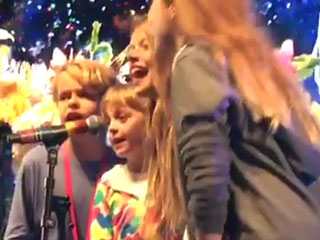 The Cutest Backup Singers! Gwyneth Paltrow Films Apple and Moses Helping Out Dad Chris Martin on Stage at Glastonbury