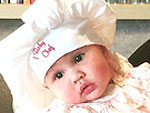Chrissy Teigen's Daughter Luna Suits Up in the Kitchen: See the Budding Chef