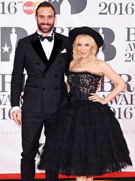 Brit Awards 2016: Kylie Minogue Walks Red Carpet with Joshua Sasse