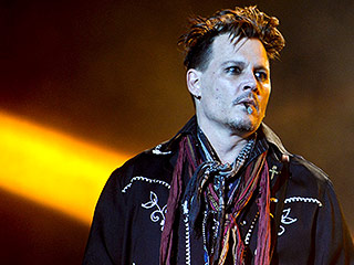 Johnny Depp Seemed 'Totally with It' at Friday Night's Performance in Lisbon, Hours After Amber Heard Accused Him of Domestic Abuse