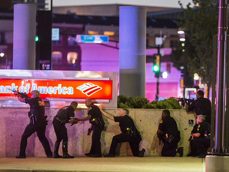 Ten police officers shot and three killed by two snipers