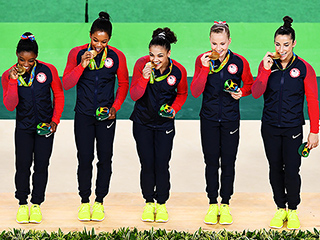 WATCH: The Final Five Are Back With Gold! Did They Feel Safe in Rio?