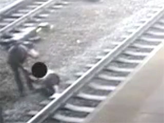 Watch: Hero Cop Rescues Allegedly Suicidal Man From Tracks Moments Before Train Goes By