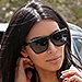 Kim Kardashian West Stops Traffic In Fluorescent Orange Cut-Out Mini Dress