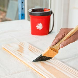 painter Mauro Henrique wipes applies finish in the TOH TV Cambridge house