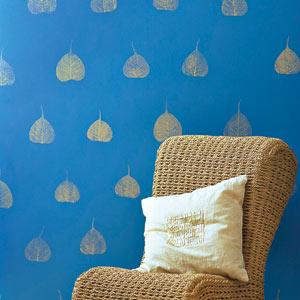 blue painted wall with leaf-stamped gold pattern paint idea