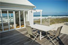 weathered deck on a beach cottage overlooking the water