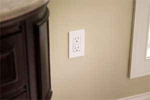 arc fault circuit interrupter installed on a beige wall next to a window