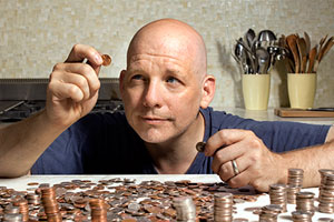 Scott Omelianuk with a pile of pennies