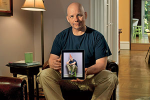 Scott Omelianuk with iPad displaying his own image