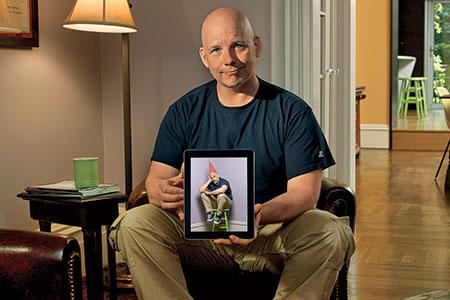 Scott Omelianuk with iPad displaying his own image