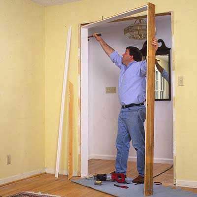 Use a claw hammer to pry the existing doorjambs from the opening
