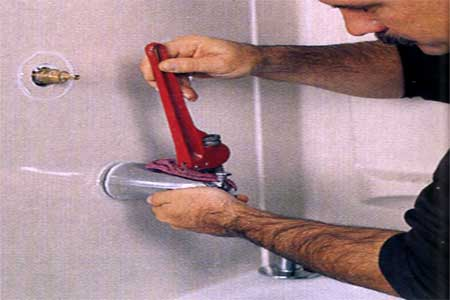 removing the tub spout with a pipe wrench